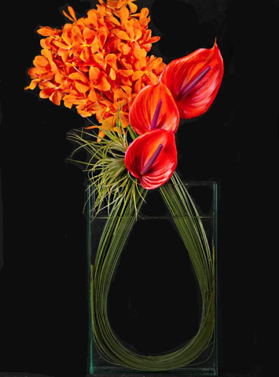 Nietypowa aranżacja kwiatowa ze storczyków i antrium