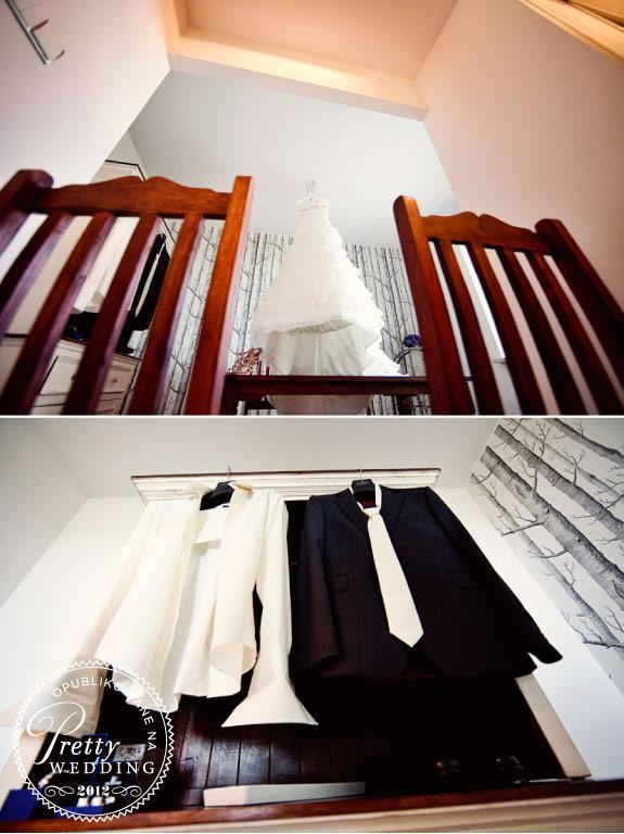 Biała suknia ślubna i garnitur Pana Młodego z białym krawatem